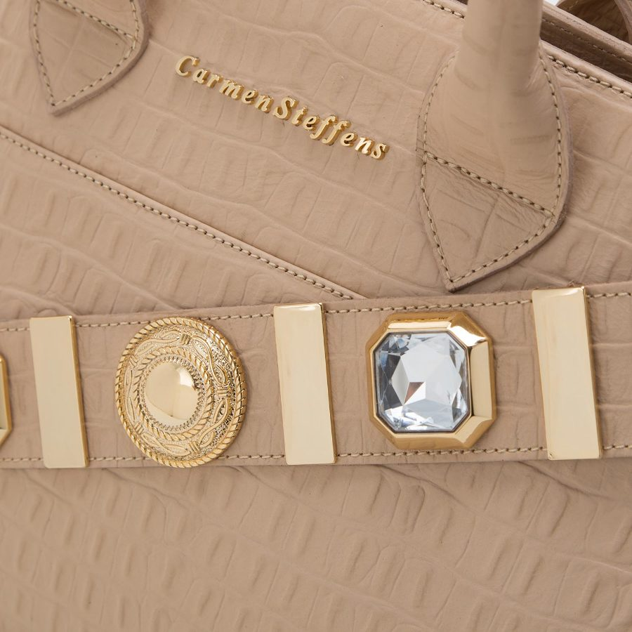 Handbag with studded strap