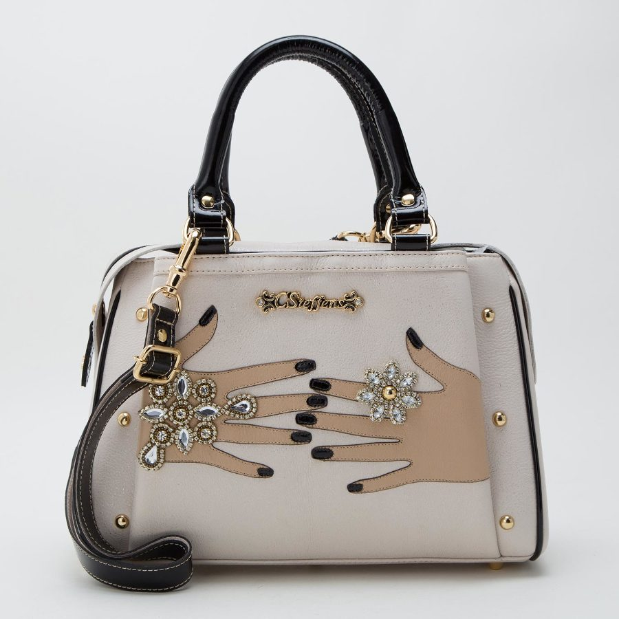 Handbag with laser-cut details