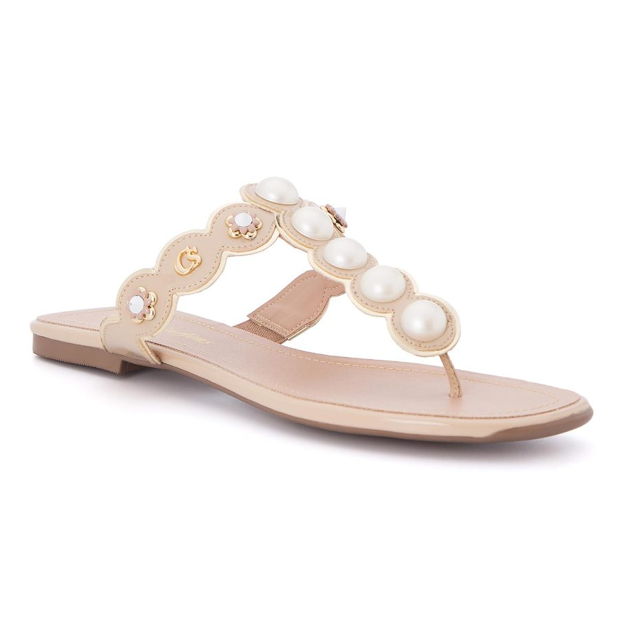 Flat sandal with pearls and metal studs