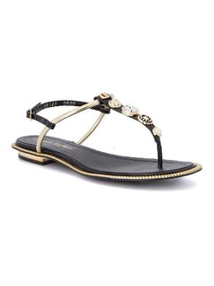 T-strap flat sandal with metal details front