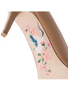 Stiletto with brand initials